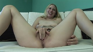 Blonde on Couch Spreads Her Legs and Shows Her Pussy
