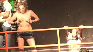 Sizzling Whores Squeezed Their Boobs on Stage