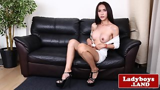 Classy ladyboy tugs her cock after teasing